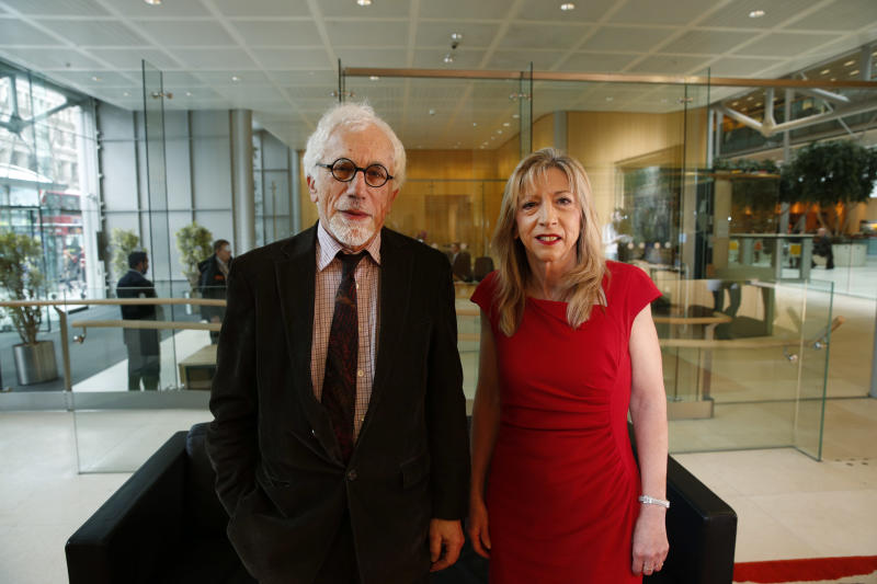 """Joe Herbert, left, Emeritus Professor of Neuroscience at the University of Cambridge and Barbara Sahakian, right, professor of Clinical Neurophychology at the same university, pose prior to a news conference to announce the results of a new study in central London, Monday, Feb. 17, 2014. A saliva test for teenage boys with mild symptoms of depression could help predict those who will later develop major depression, the new study says. Researchers who measured cortisol levels in teenagers found that boys with high levels of the hormone and mild depression symptoms were 14 times more likely to later suffer from clinical depression than those with low levels. Herbert said: """"You don't have to rely simply on what the patient tells you, but what you can measure inside the patient,"""" comparing the new test to those done for other health problems, like heart disease, which evaluate things like cholesterol and high blood sugar to determine a patient's risk. (AP Photo/Lefteris Pitarakis)"""