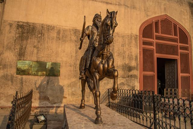 Statue of Maharaja Ranjit Singh outside his last rest place in Lahore Fort, Pakistan. (Getty)
