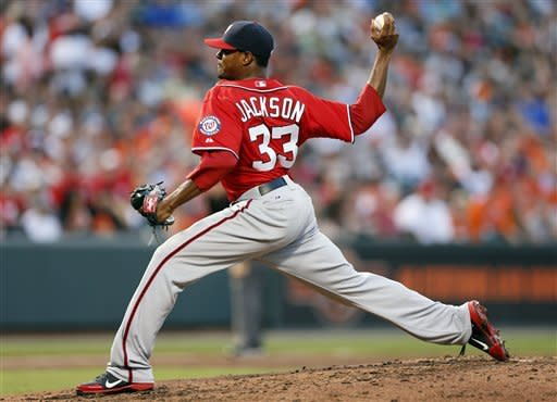 Washington Nationals starting pitcher Edwin Jackson throws to the Baltimore Orioles in the third inning of an interleague baseball game in Baltimore, Saturday, June 23, 2012. (AP Photo/Patrick Semansky)
