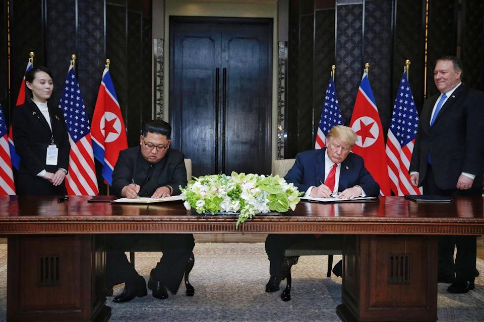 Kim Jong-un and Donald Trump sign their agreement in Singapore (Picture: Getty)