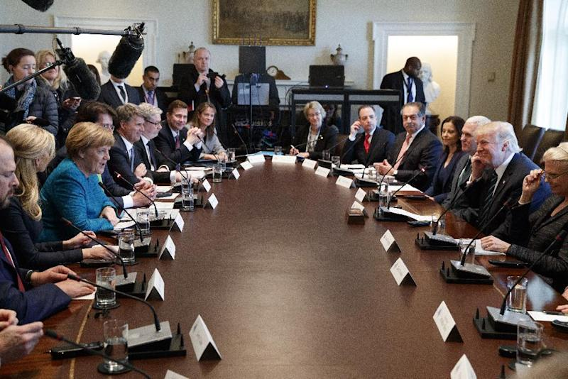 President Donald Trump and German Chancellor Angela Merkel participate in a roundtable discussion on vocational training with German and American business leaders, Friday, March 17, 2017, at the White House in Washington. (AP Photo/Evan Vucci)