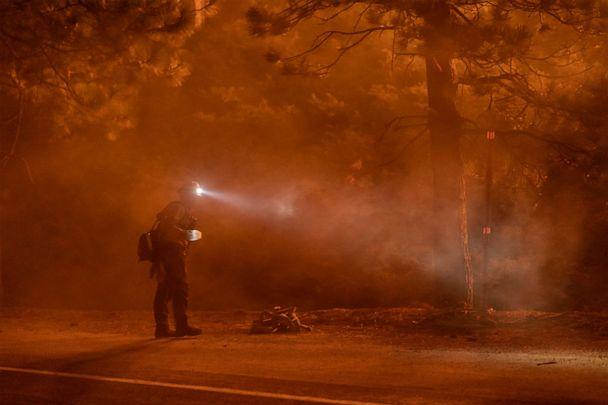 PHOTO: A firefighter keeps watch on flames that could jump the Angeles Crest Highway at the Bobcat Fire in the Angeles National Forest on Sept. 11, 2020, north of Monrovia, Calif. (David Mcnew/Getty Images)