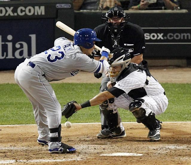 Chicago White Sox catcher Adrian Nieto lets a pitch from Chicago White Sox's Scott Carroll, get past him as Kansas City Royals' Norichika Aoki draws the walk during the sixth inning of a baseball game Tuesday, July 22, 2014, in Chicago. Raul Ibanez scored on the play. (AP Photo/Stacy Thacker)