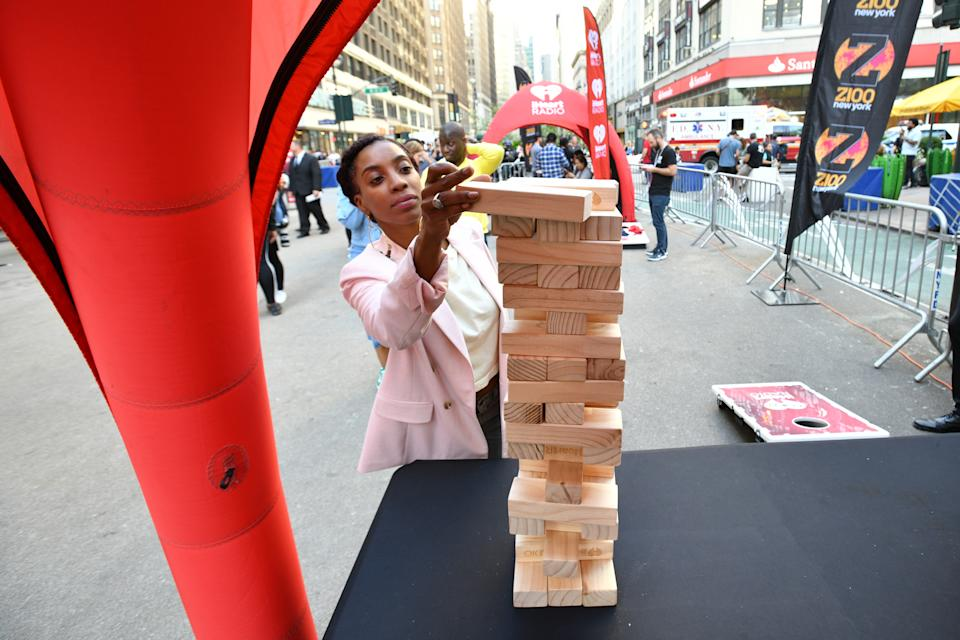 NEW YORK, NEW YORK - SEPTEMBER 27: A guest plays Jenga at iHeartRadio's Z100 Jingle Ball 2019 presented by Capital One® official Kickoff at Herald Square Plaza on September 27, 2019 in New York City. (Photo by Bryan Bedder/Getty Images for iHeartRadio)