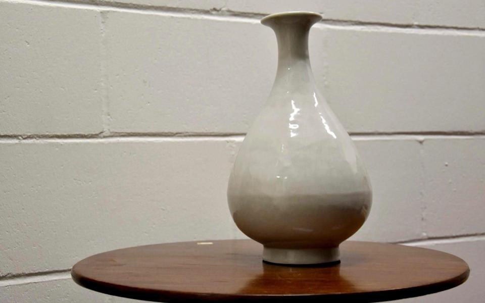 A stolen 15th century Chinese Ming Dynasty vase which has been recovered by the Metropolitan Police during a Specialist Crime operation - Metropolitan Police