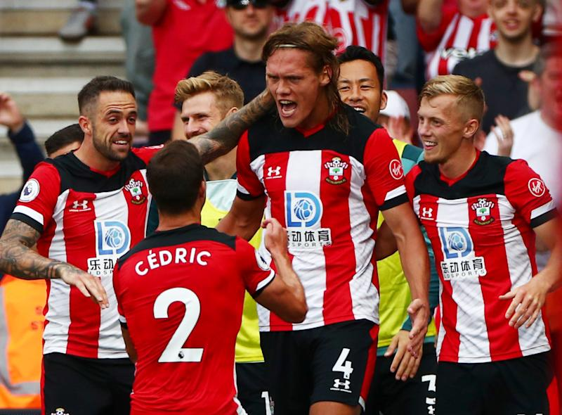 """Soccer Football - Premier League - Southampton v Manchester United - St Mary's Stadium, Southampton, Britain - August 31, 2019 Southampton's Jannik Vestergaard celebrates scoring their first goal with teammates REUTERS/Hannah Mckay EDITORIAL USE ONLY. No use with unauthorized audio, video, data, fixture lists, club/league logos or """"live"""" services. Online in-match use limited to 75 images, no video emulation. No use in betting, games or single club/league/player publications. Please contact your account representative for further details."""