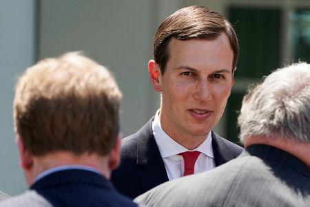 Kushner speaks with guests after U.S. President Trump discussed U.S. immigration policy at the White House in Washington