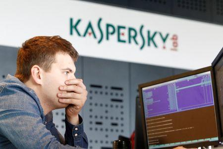 FILE PHOTO - An employee works near screens in the virus lab at the headquarters of Russian cyber security company Kaspersky Labs in Moscow