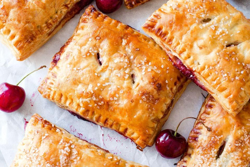 """<p>Store-bought puff pastry = best cherry pie shortcut ever.</p><p>Get the recipe from <a href=""""https://www.delish.com/cooking/recipe-ideas/recipes/a43250/cherry-puff-pastry-pies-recipe/"""" rel=""""nofollow noopener"""" target=""""_blank"""" data-ylk=""""slk:Delish"""" class=""""link rapid-noclick-resp"""">Delish</a>.</p><p><em><strong><em><strong>BUY NOW: Calphalon Nonstick Bakeware, $30; <a href=""""https://www.amazon.com/Calphalon-Nonstick-Bakeware-Baking-2-Piece/dp/B008BUKO6G/?tag=syn-yahoo-20&ascsubtag=%5Bartid%7C1782.g.2750%5Bsrc%7Cyahoo-us"""" rel=""""nofollow noopener"""" target=""""_blank"""" data-ylk=""""slk:amazon.com"""" class=""""link rapid-noclick-resp"""">amazon.com</a>.</strong></em></strong></em><br></p>"""