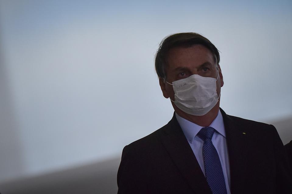 Brazil's President Jair Bolsonaro arrives at the Emergency Aid Extension ceremony at the Planalto Palace in Brasília, Brazil, on June 30, 2020. The Emergency Aid is a financial benefit granted by the Federal Government to workers and unemployed people affected by the Coronavirus (COVID-19) pandemic. (Photo by Andre Borges/NurPhoto via Getty Images)
