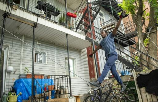 Antino Pansa, 20, installed a slack wire between two trees at his apartment in Montreal, so that he could continue practicing his circus skills