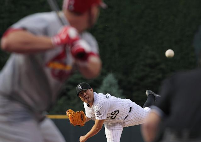 Colorado Rockies starter Jorge De La Rosa (29) pitches to St. Louis Cardinals' Matt Holliday in the first inning of a baseball game in Denver on Tuesday, June 24, 2014. (AP Photo/Joe Mahoney)