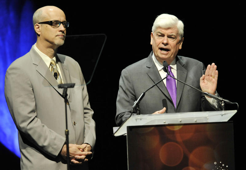 Christopher Dodd, right, Chairman and CEO of the Motion Picture Association of America, is joined by National Association of Theatre Owners president and CEO John Fithian during CinemaCon 2013's State of the Industry address at Caesars Palace on Tuesday, April 16, 2013 in Las Vegas. (Photo by Chris Pizzello/Invision/AP)