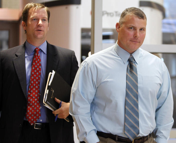 """FILE -In this Oct. 4,2011 file photo former CIA contractor Raymond Davis, right, and his attorney William Frankfurt arrive at the Douglas County Courthouse in Castle Rock, Colo., for a court hearing on felony assault charges. Police say the widow and mother-in-law of one of two Pakistani men shot and killed by a CIA contractor last year have been murdered in the eastern city of Lahore, Monday, April 30, 2012. It appears Monday's killings may have been related to the large amount of """"blood money"""" Zohra Haider received to pardon her husband's killer, Raymond Davis. (AP Photo/Ed Andrieski)"""