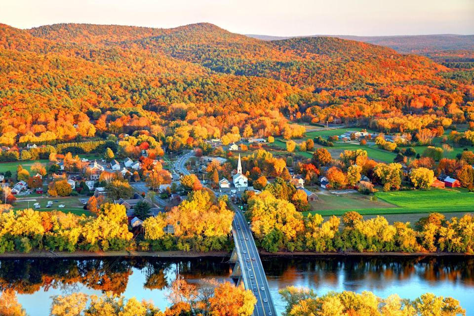 """<p><strong>Where to go:</strong> The Pioneer Valley region of Massachusetts ranks among the best places to go leaf peeping. The view from Mount Sugarloaf includes the charming town of South Deerfield, the Connecticut River, and brilliant yellow, amber, and gold foliage. </p><p><strong>When to go: </strong><a href=""""https://www.mass.gov/location-details/fall-foliage-season-in-the-parks"""" rel=""""nofollow noopener"""" target=""""_blank"""" data-ylk=""""slk:October"""" class=""""link rapid-noclick-resp"""">October</a></p><p><a class=""""link rapid-noclick-resp"""" href=""""https://go.redirectingat.com?id=74968X1596630&url=https%3A%2F%2Fwww.tripadvisor.com%2FHotels-g28942-Massachusetts-Hotels.html&sref=https%3A%2F%2Fwww.redbookmag.com%2Flife%2Fg34045856%2Ffall-colors%2F"""" rel=""""nofollow noopener"""" target=""""_blank"""" data-ylk=""""slk:FIND A HOTEL"""">FIND A HOTEL</a></p>"""