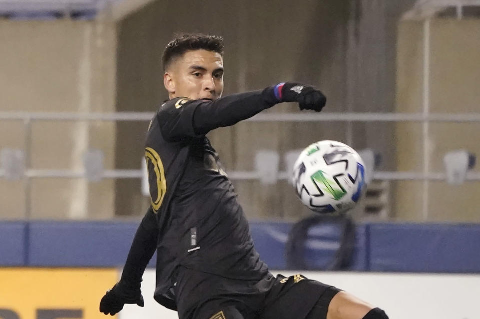 Los Angeles FC midfielder Eduard Atuesta scores against the Seattle Sounders during the second half of an MLS playoff soccer match, Tuesday, Nov. 24, 2020, in Seattle. The Sounders won 3-1. (AP Photo/Ted S. Warren)