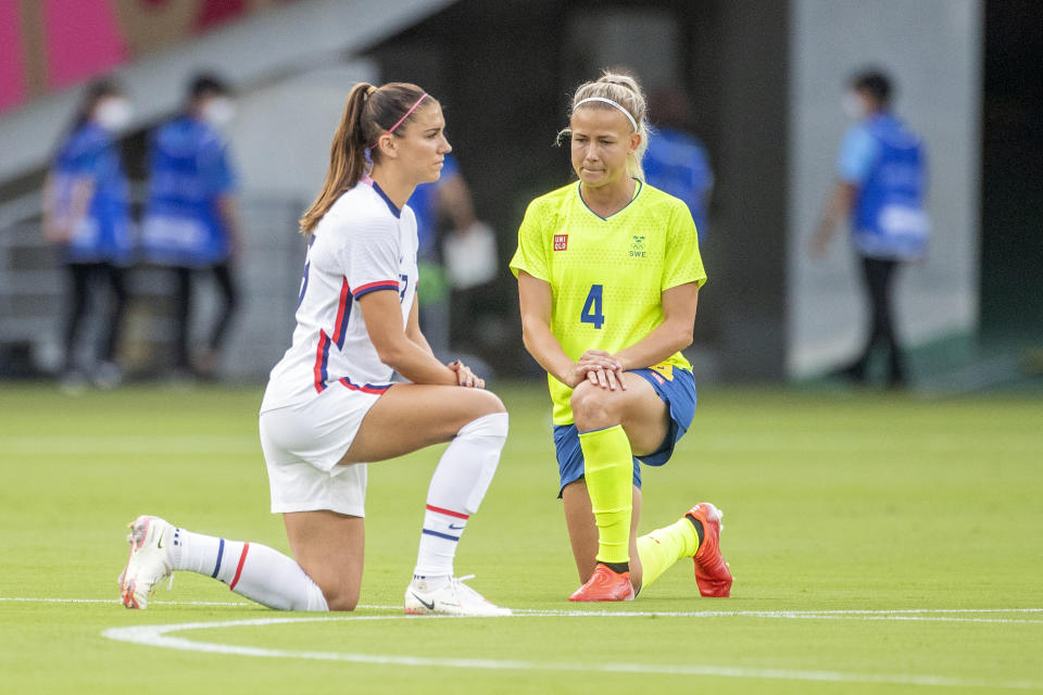 The USWNT and Sweden knelt before their opener on Wednesday. You wouldn't have known that from postgame highlight packages and social media clips, at least for a brief period of time. (Photo by Tim Clayton/Corbis via Getty Images)