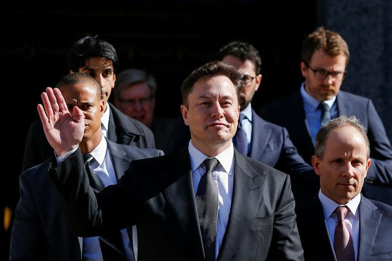 FILE PHOTO: Tesla Inc. CEO Elon Musk exits after attending for an S.E.C. hearing at the Manhattan Federal Courthouse in New York, April 4, 2019. REUTERS/Eduardo Munoz - RC14FDBB9430/File Photo