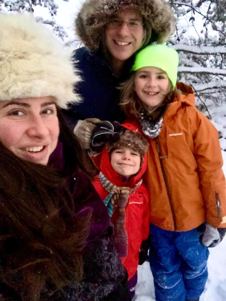 Carly Stasko, her husband Trevor, and their two kids pose outside. (Photo: Carly Stasko)