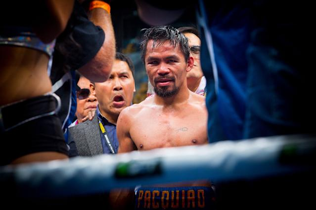 Manny Pacquiao says there have been talks to make a fight with UFC lightweight champion Conor McGregor, but both Top Rank chairman Bob Arum and UFC president Dana White deny it. (Getty Images)