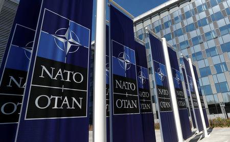 Banners displaying the NATO logo are placed at the entrance of new NATO headquarters during the move to the new building, in Brussels, Belgium April 19, 2018.  REUTERS/Yves Herman