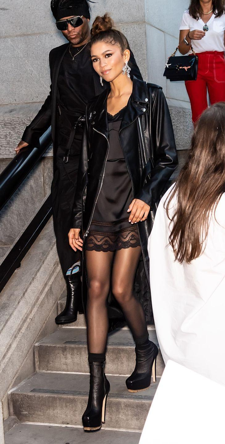 <p>A slip dress is an universal piece to have. Zendaya styles it expertly with a loose-fit moto jacket and big, dangly earrings.</p>