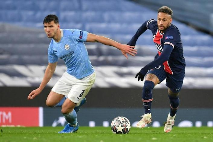 Manchester City's Ruben Dias (left) helped keep PSG star Neymar (right)quiet