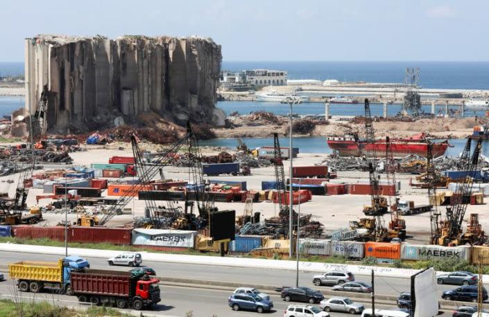 FILE PHOTO: Vehicles drive near the grain silo that was damaged during Beirut port explosion, in Beirut