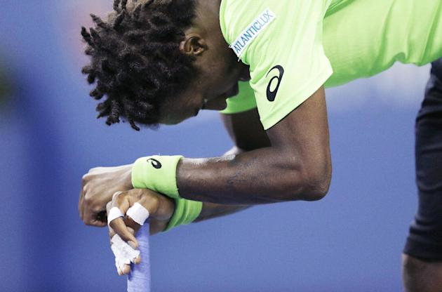 Gael Monfils, of France, rests on his racket after losing a point during the fifth set against Roger Federer.(AP Photo/Charles Krupa)