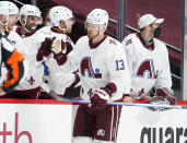 Colorado Avalanche right wing Valeri Nichushkin, front, is congratulated as he passes the team box after scoring a goal against the Anaheim Ducks in the second period of an NHL hockey game Friday, March 5, 2021, in Denver. (AP Photo/David Zalubowski)