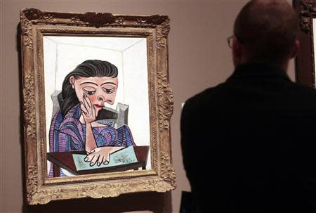 A visitor stops to look at a painting by Picasso at the Detroit Institute of Arts in Detroit, Michigan in this June 2, 2013 file photo. REUTERS/Rebecca Cook/Files