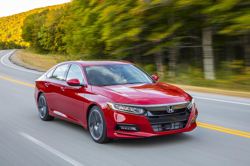 This photo provided by Honda shows the Accord, which has a long history of excellence as a family sedan. It's under mounting pressure from the all-new Kia K5, though. Can this new upstart unseat the established veteran? (Courtesy of Honda North America via AP)