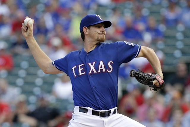 Texas Rangers starting pitcher Nick Tepesch (23) works against the Minnesota Twins in the first inning of a baseball game, Friday, June 27, 2014, in Arlington, Texas. (AP Photo/Tony Gutierrez)