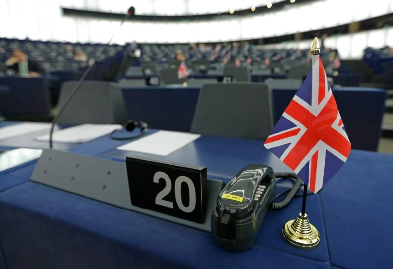 FILE PHOTO: A British Union Jack flag is seen on the desk of Farage, leader of the UKIP and MEP, ahead of a debate at the European Parliament in Strasbourg