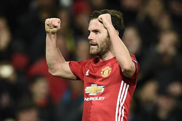 "Manchester United's midfielder Juan Mata wrote, ""Now it's time to play two good games to close the Premier League and reach the Europa League final in the best shape that we can"" (AFP Photo/Oli SCARFF )"