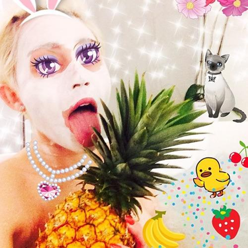 """""""Splish Splashhhh"""" she was taking a bath! Why shower by yourself when you can have a sudd-filled celebration with a pineapple, some bananas, a lone strawberry, some cherries, a baby chicken, a cat, some flowers, a lovely jewelled necklace and some bunny ears? By the way Miley, loving the new contact lenses… colour definitely suits you!"""
