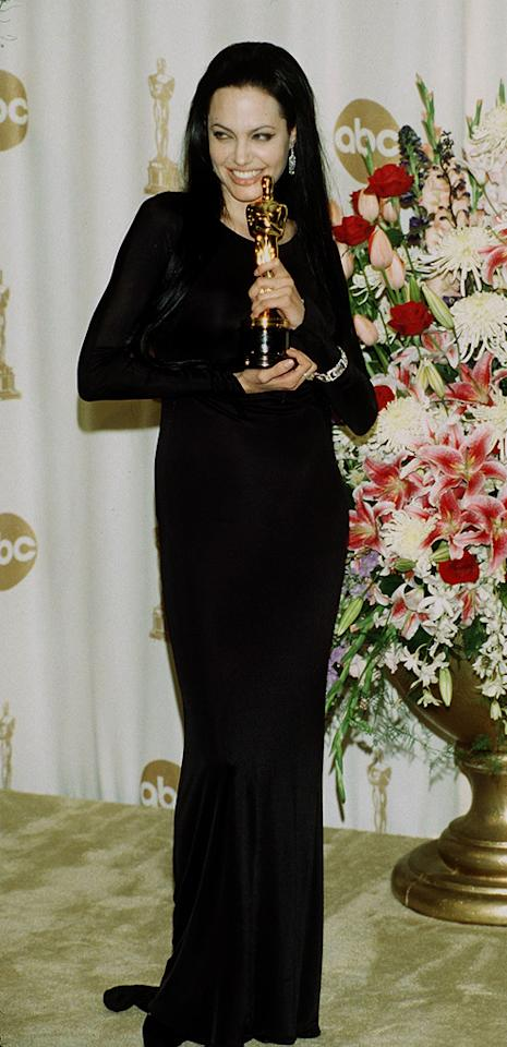 """3. 72nd Annual Academy Awards (2000)   Angie channeled her inner Elvira while getting gussied up in this goth Versace gown for the 72nd Annual Oscars, where she collected a Best Supporting Actress statue for her role in """"Girl, Interrupted."""""""