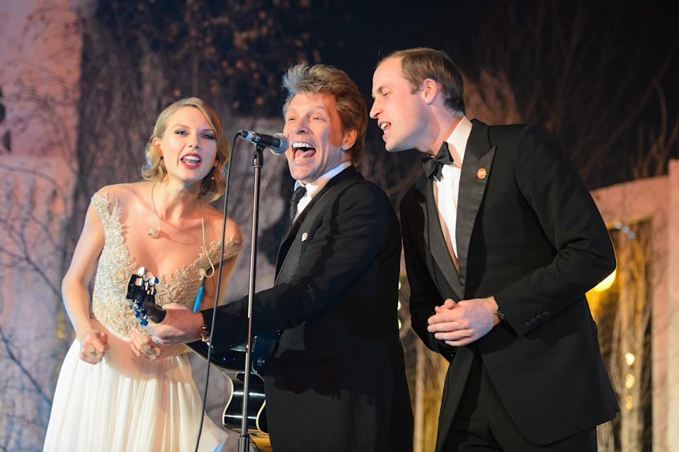 Prince Harry may have roped in Bon Jovi to sing the Invictus single, but William got to the rock star first. Singing with him and Taylor Swift in 2013. (Dominic Lipinski/PA Wire)