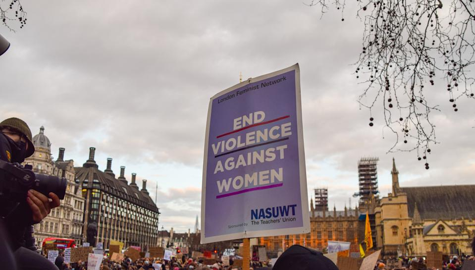A protester holds a placard that says End Violence Against Women during the demonstration. Crowds of people gathered in London to protest against the heavy-handed response by the police at the Sarah Everard vigil, as well as the government's new Police, Crime, Sentencing and Courts Bill, which would give the police new powers to deal with protests. (Photo by Vuk Valcic / SOPA Images/Sipa USA)