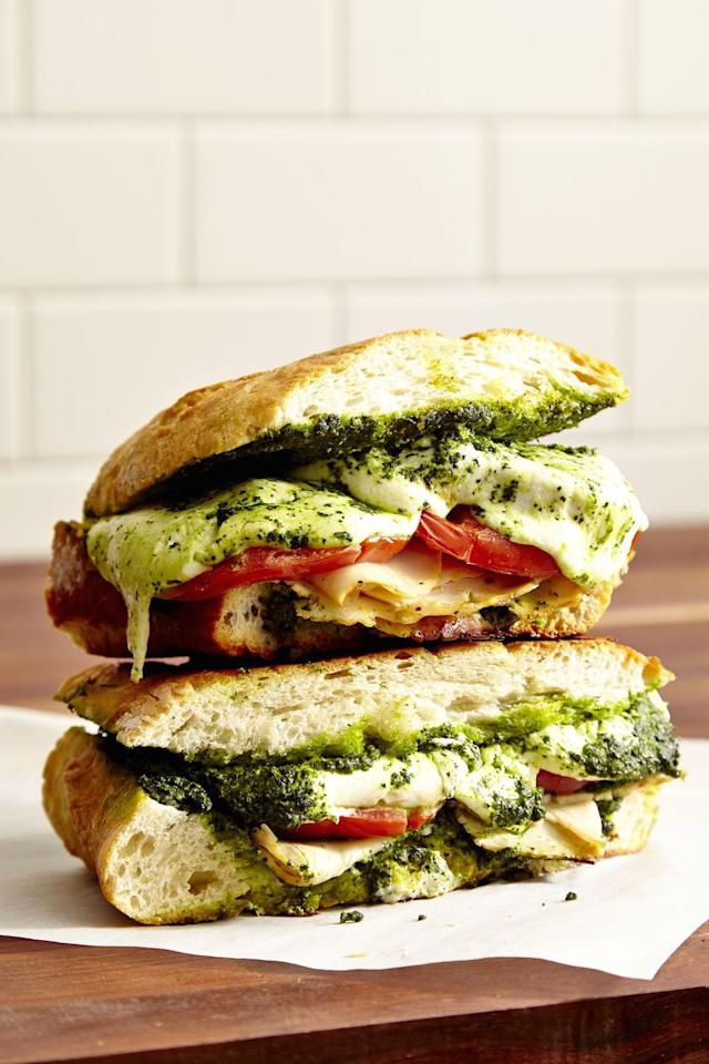 "<p>No panini press, no problem. All you need is a skillet and heavy pan to create this focaccia bread panini filled with turkey, mozzarella, and kale pesto. </p><p><strong>Get the recipe at <a rel=""nofollow"" href=""https://www.delish.com/cooking/recipe-ideas/recipes/a46640/turkey-mozzarella-kale-pesto-panini-recipe/"">Delish. </a></strong></p>"