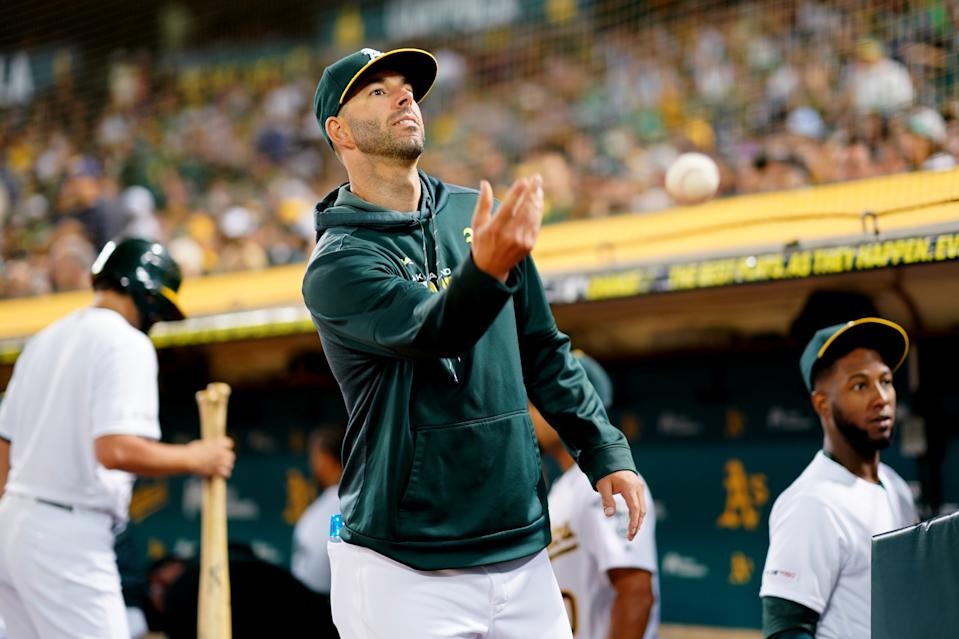 OAKLAND, CA - SEPTEMBER 21:  Mike Fiers #50 of the Oakland Athletics tosses a baseball in front of the dugout during the game between the Texas Rangers and the Oakland Athletics at Oakland Coliseum on Saturday, September 21, 2019 in Oakland, California. (Photo by Daniel Shirey/MLB Photos via Getty Images)