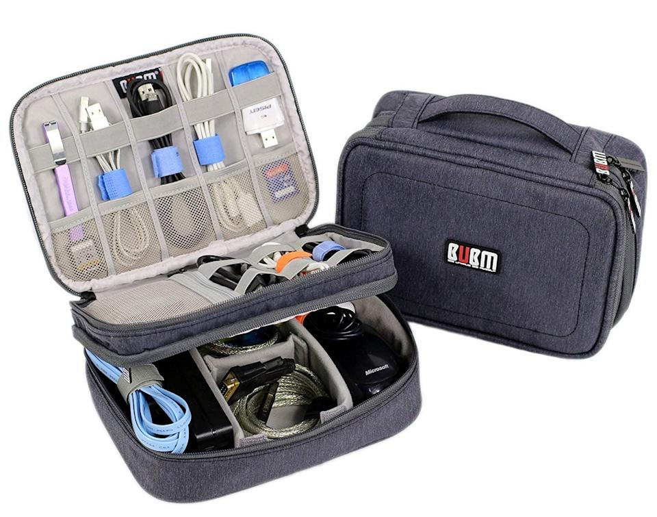 <p>An unorganized traveler who's always on the go could get some use out of this handy <span>Electronics Organizer Travel Cable Cord Bag</span> ($18). All the little sections are so useful.</p>