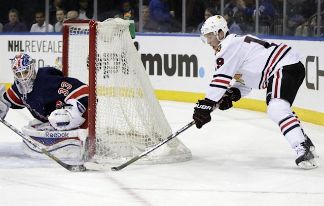 New York Rangers goalie Cam Talbot (33) defends the crease as Chicago Blackhawks center Jonathan Toews (19) looks for a shot during the first period of an NHL hockey game at Madison Square Garden in New York, Thursday, Feb. 27, 2014. The Rangers defeated the Blackhawks 2-1. (AP Photo/Kathy Willens)
