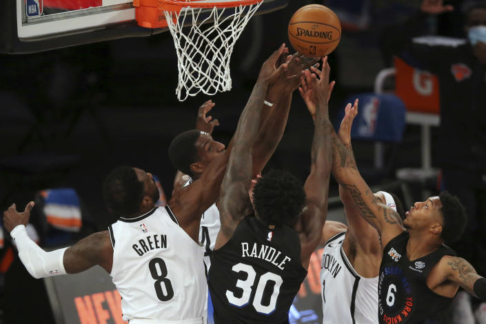 Brooklyn Nets forwards Jeff Green (8) and forward Reggie Perry (14) and guard Bruce Brown (1) fight for a rebound against New York Knicks forward Julius Randle (30) and guard Elfrid Payton (6) during the second quarter of an NBA basketball game Wednesday, Jan. 13, 2021, in New York. (Brad Penner/Pool Photo via AP)