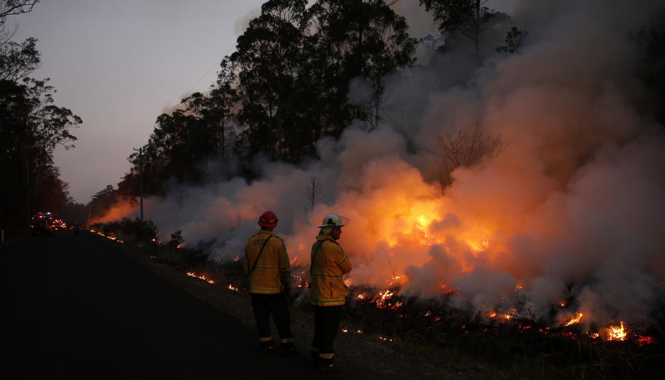 Almost 1200 firefighters are tackling large bushfires on the NSW mid-north coast among scores of blazes around NSW. Source: AAP Image.