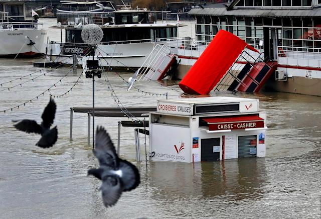 <p>A ticket booth for sightseeing boats is partly submerged by the River Seine after days of almost non-stop rain caused flooding in the country, in Paris, France, Jan. 27, 2018. (Photo: Pascal Rossignol/Reuters) </p>