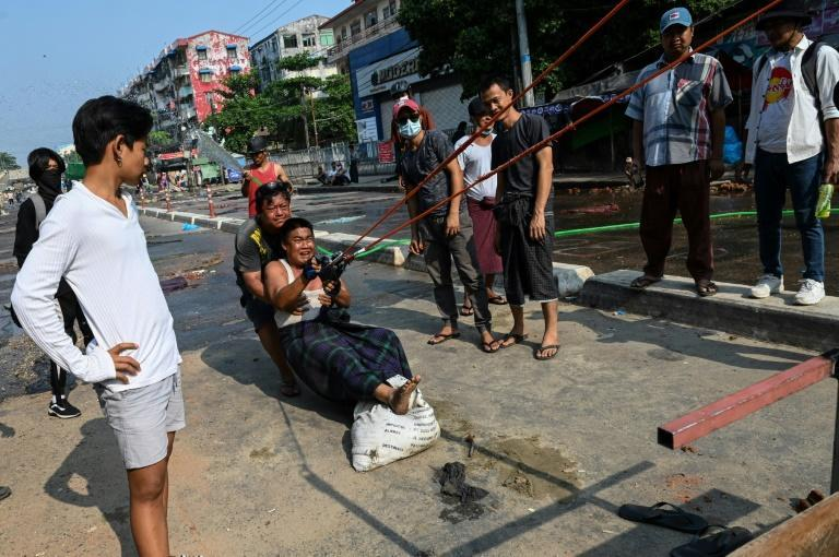 Anti-coup protesters in Yangon test a giant slingshot to shoot projectiles