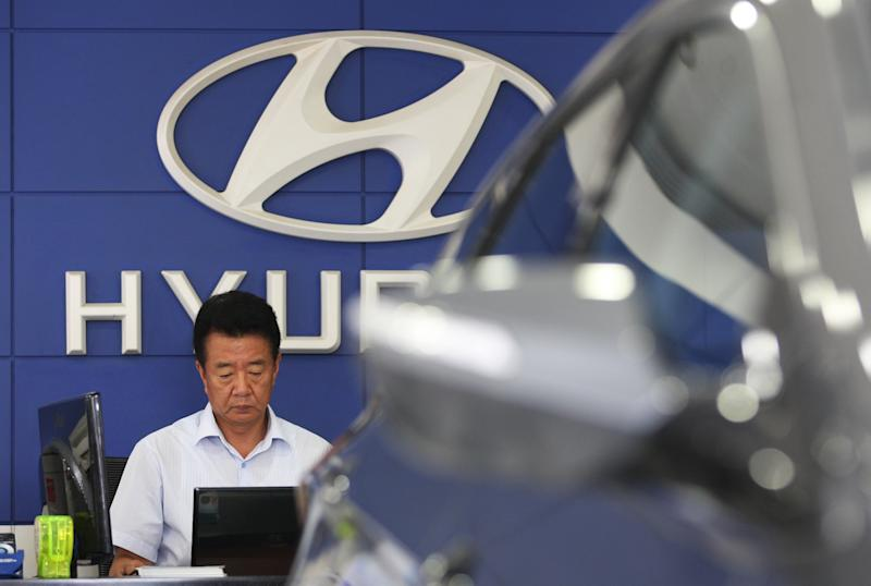 An employee of Hyundai Motor Co. works at the company's showroom in Seoul, South Korea, Thursday, July 26, 2012. Hyundai Motor said its second quarter net profit rose 10 percent, driven by demand for its vehicles in overseas markets. (AP Photo/Ahn Young-joon)