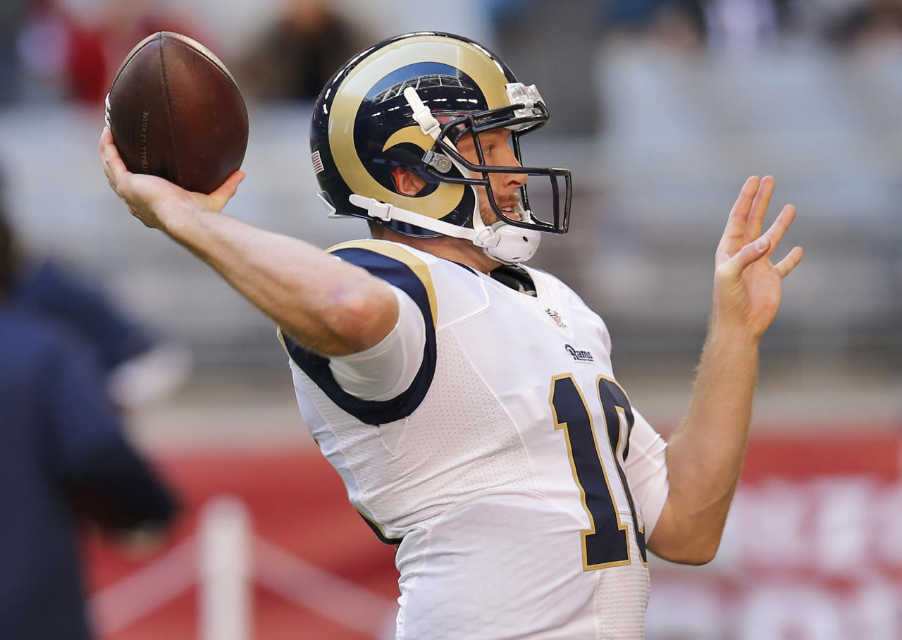 St. Louis Rams quarterback Kellen Clemens (10) warms up prior to an NFL football game against the Arizona Cardinals, Sunday, Dec. 8, 2013, in Glendale, Ariz. (AP Photo/Matt York)