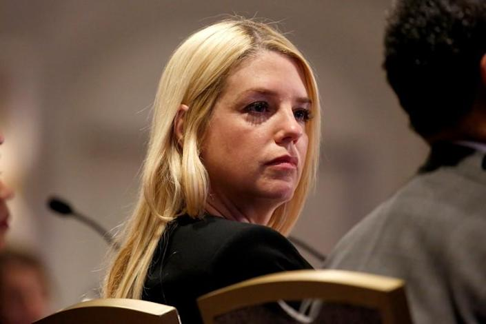FILE PHOTO: Florida Attorney General Pam Bondi listens to U.S. Attorney General Jeff Sessions as he speaks to the National Association of Attorneys General 2018 Winter Meeting in Washington